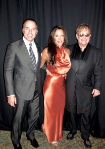 With David Furnish and Elton John at the Fashion Cares Event.