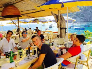 Relaxing in Capris, Italy at lunch with our children - Summer, 2015.