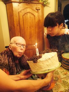 """""""My mother...sharing the candle with her youngest granddaughter."""""""